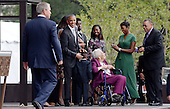 United States President Barack Obama and former President George W. Bush (L) share the stage with the Bonner Family during the opening ceremony of the Smithsonian National Museum of African American History and Culture on September 24, 2016 in Washington, DC. The museum is opening thirteen years after Congress and President George W. Bush authorized its construction. <br /> Credit: Olivier Douliery / Pool via CNP