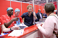 19 April 2017 - Prince Harry helps staff and meets runners as he officially opens the Virgin Money London Marathon Expo at ExCel in London. Prince Harry, who is Patron of the London Marathon Charitable Trust, will meet runners and hand out race numbers, along with special edition Heads Together headbands, which is the official Charity of the Year for this year's marathon. Photo Credit: ALPR/AdMedia