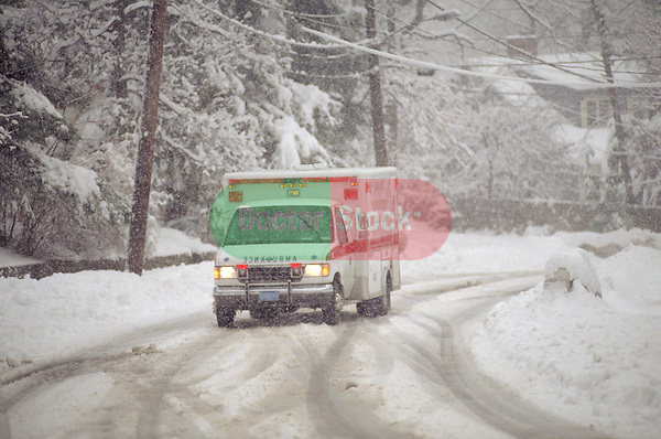 ambulance driving in a snowstorm