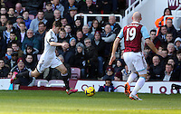 Pictured L-R: Ben Davies of Swansea against James Collins of West Ham. 01 February 2014<br />