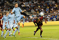Sporting KC defender Michael Harrington (pale blue) clears the ball from a corner... Sporting Kansas City defeated Real Salt Lake 2-0 at LIVESTRONG Sporting Park, Kansas City, Kansas.