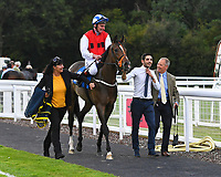 Winner of The Simpson Hilder Associates Supporting Gift Of Sight EBF Fillies' Novice Stakes,Star in the Making ridden by Adam Kirby and trained by Clive Cox  is led into the Winner's enclosureduring Evening Racing at Salisbury Racecourse on 3rd September 2019