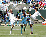 9 June 2007: El Salvador's Alfredo Pacheco (left) and Ramon Sanchez (right) converge on Guatemala's Mario Rodriguez (center). The National Team of Guatemala defeated the National Team of El Salvador 1-0 at the Home Depot Center in Carson, California in a first round game in the CONCACAF Gold Cup.