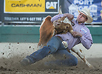 Bridger Anderson competes in the Steer Wrestling event during the Reno Rodeo on Sunday, June 23, 2019.