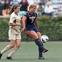Pepperdine University defender Mandy Davis (7) volley pass as Boston College defender McKenzie Meehan (22) closes. Pepperdine University defeated Boston College,1-0, at Soldiers Field Soccer Stadium, on September 29, 2012.