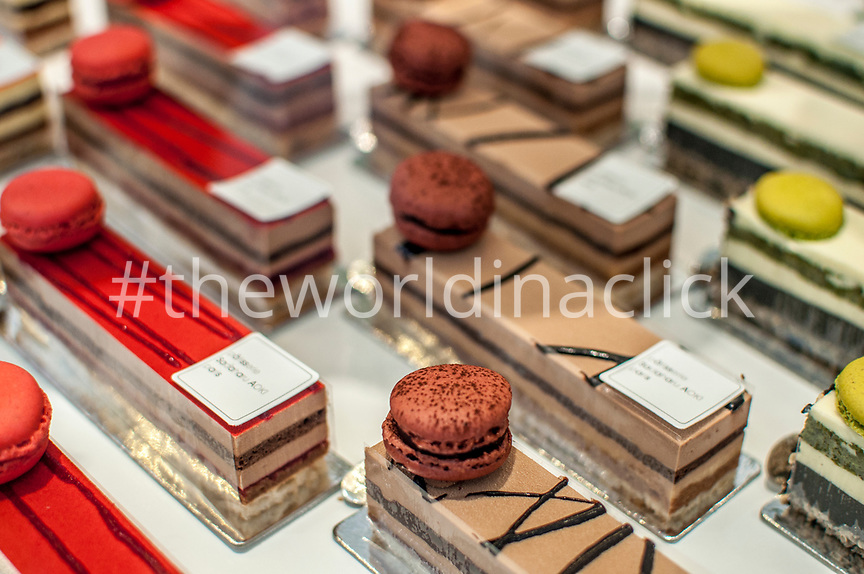 FRANCE, Paris, Red, Brown and Greet Cakes and macaroons in Aoki French Japanese Patissery