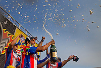Jul. 28, 2013; Sonoma, CA, USA: NHRA pro stock motorcycle rider Hector Arana Jr celebrates with champagne after winning the Sonoma Nationals at Sonoma Raceway. Mandatory Credit: Mark J. Rebilas-