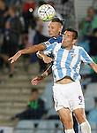 Getafe's Alexis Ruano (b) and Malaga's Charles Dias during La Liga match.September 18,2015. (ALTERPHOTOS/Acero)