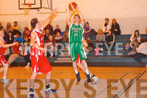 St Brendan's Jason Quirke takes his shot against Templeogue at Mounthawk gym, Tralee on Sunday.