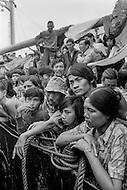 "28 Dec 1978, Manila, Luzon Island, Philippines --- Boat people stranded on the ship ""Tung-An"", off the coast of Manila after an exodus from Vietnam. The 2700 Vietnamese refugees on board do not have the permission to disembark into the Philippines. Hungry, tired, and scared, living in unbearable conditions, the boat people must wait until a host country accepts them. --- Image by © JP Laffont"