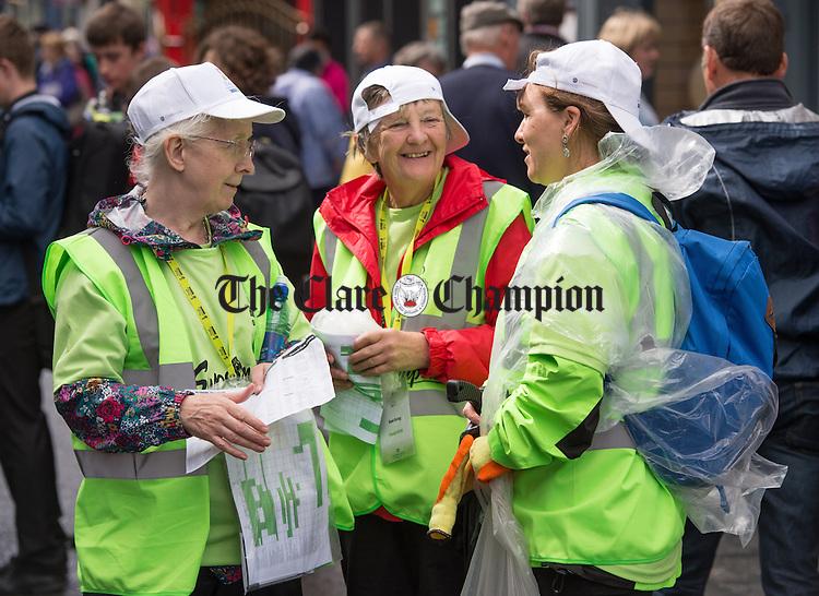 Volunteers; Anne Stewart, Rose Casey and Nuala Ni Ghabhann confer on Abbey street during Fleadh Cheoil na hEireann in Ennis. Photograph by John Kelly.