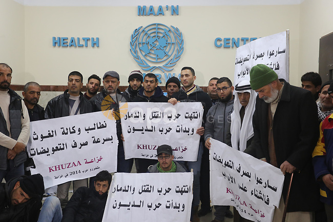 Palestinian owners of houses which were destroyed during the recent Israeli war, take part in a protest demanding repair their houses, at a United Nations-run health center, in Khan Younis in the southern of Gaza strip, on January 20, 2020. Photo by Ashraf Amra