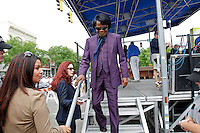 James Brown walks off a stage after being the guest starter of the 2006 Ford Tour de Georgia pro cycling race in Augusta, Ga. on Tuesday, April 18, 2006. His long-time partner, Tomi Rae Hynie, is second from left. James Brown died in Atlanta on Monday, Dec. 25.