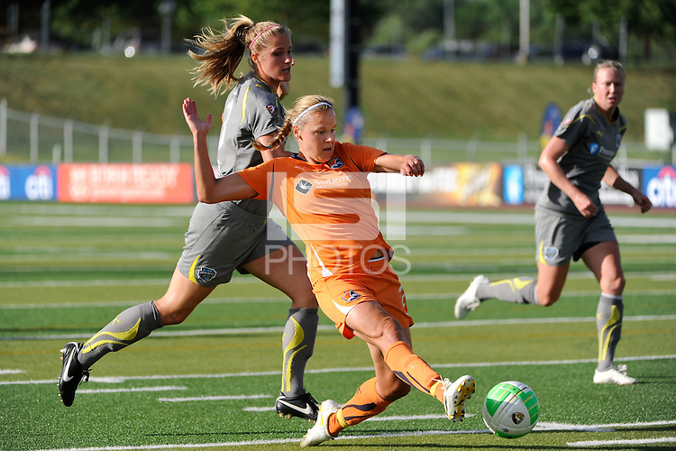 Laura Kalmari (21) of Sky Blue FC shoots and scores during a Women's Professional Soccer (WPS) match against the Philadelphia Independence at John A. Farrell Stadium in West Chester, PA, on June 6, 2010.