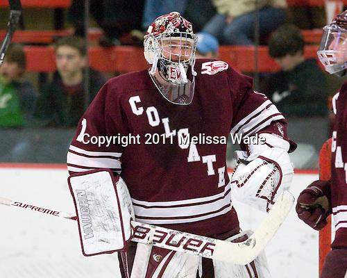 Alex Evin (Colgate - 1) - The Harvard University Crimson defeated the visiting Colgate University Raiders 6-2 (2 EN) on Friday, January 28, 2011, at Bright Hockey Center in Cambridge, Massachusetts.
