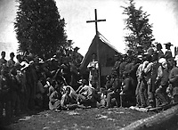 Religious services in camp, Catholic.  Probably 69th New York State Militia.  Mathew Brady Collection.  (War Dept.)<br /> Exact Date Shot Unknown<br /> NARA FILE #:  165-C-100<br /> WAR &amp; CONFLICT BOOK #:  221