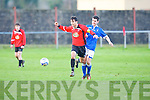 Tralee Dynamos Uros Ivkovic and Limerick FC's Alex Scully...
