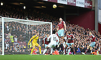 Sunday 07 December 2014<br /> Pictured: Andy Carroll of West Ham jumps for a header<br /> Re: Premier League West Ham United v Swansea City FC at Boleyn Ground, London, UK.