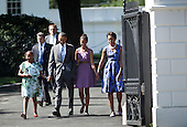 United States President Barack Obama (2L) and first lady Michelle Obama (R) walk with their daughters Sasha (L) and Malia (2R) from the White House to St. John's Protestant Episcopal Church July 17, 2011 in Washington, DC.  The First Family attended Sunday services..Credit: Brendan Smialowski / Pool via CNP