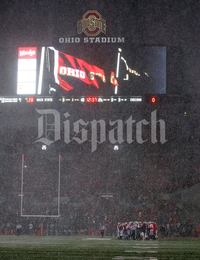 Snow falls during the third quarter of the the Ohio State Buckeyes and Indiana Hoosiers college football game at Ohio Stadium in Columbus, Ohio on November 23, 2013.  (Dispatch photo by Kyle Robertson)