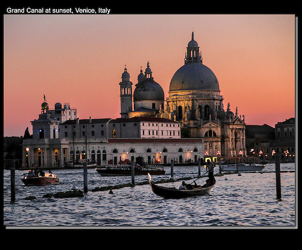 Bascillica and gondolier on Grand Canal at sunset, Venice, Italy.