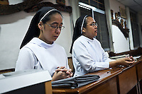 Sister Gertrude praying during the adoration session in the chapel of the Divine World hospital. <br /> <br /> Soeur Gertrude prie pendant la session d'adoration dans la chapelle de l'h&ocirc;pital &quot;The Divine Wolrd Hospital&quot;.