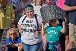 People participate in a rally outside a federal detention center in Sheridan, Oregon. Participants protested the Trump administration's policy of separating parents from their children at the U.S.-Mexico border.