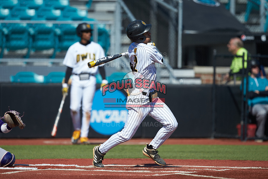 Tyler Simon (2) of the Kennesaw State Owls follows through on his swing against the Western Carolina Catamounts at Springs Brooks Stadium on February 22, 2020 in Conway, South Carolina. The Owls defeated the Catamounts 12-0.  (Brian Westerholt/Four Seam Images)