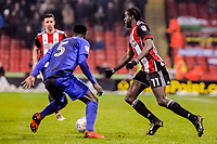 Sheffield United's forward Clayton Donaldson (11) turns inside Cardiff City's defender Bruno Ecuele Manga (5) during the Sky Bet Championship match between Sheff United and Cardiff City at Bramall Lane, Sheffield, England on 2 April 2018. Photo by Stephen Buckley / PRiME Media Images.