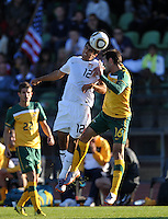 Jonathan Bornstein of USA and Carl Valeri of Australia...Football - International Friendly - USA v Australia - Ruimsig Stadium