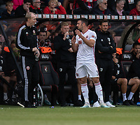 Assistant manager Alan Knill (left) giving instructions to Sheffield United's Enda Stevens (right) from the dug-out <br /> <br /> Photographer David Horton/CameraSport<br /> <br /> The Premier League - Bournemouth v Sheffield United - Saturday 10th August 2019 - Vitality Stadium - Bournemouth<br /> <br /> World Copyright © 2019 CameraSport. All rights reserved. 43 Linden Ave. Countesthorpe. Leicester. England. LE8 5PG - Tel: +44 (0) 116 277 4147 - admin@camerasport.com - www.camerasport.com