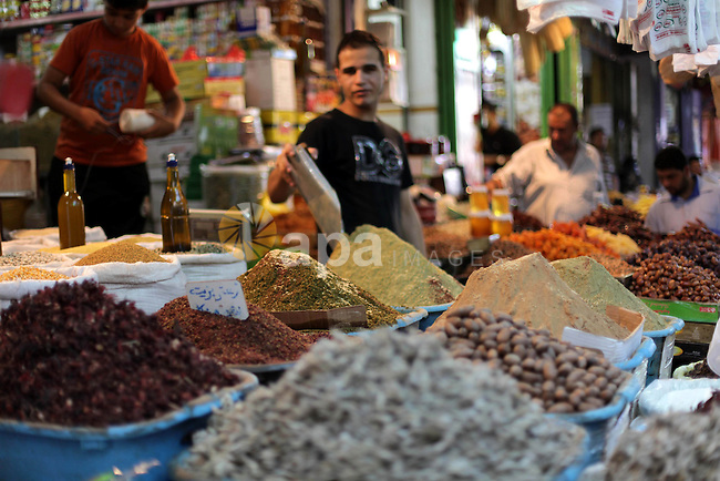 A Palestinian vendor sells spices the fourth day of the Muslim fasting month of Ramadan on July 13, 2013 in Gaza city. During Ramadan, one of the five main religious obligations under Islam, Muslims are required to abstain from food and from drinking liquids, smoking and having sex from dawn until dusk. Photo by Ashraf Amra