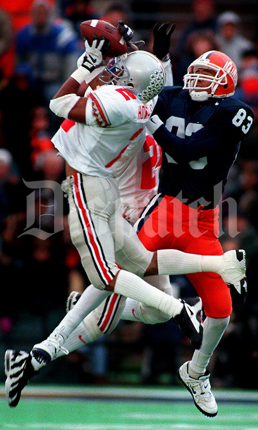 Ohio State's Ty Howard (2) intercepts in front of Illinois #83 Jason Dulick during the 1st half Nov. 9, 1996 in Champaign, IL.  (Dispatch photo by Eric Albrecht)