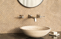 Rattan, a hand-cut tumbled mosaic, shown in Lagos Gold , is part of the Tissé™ collection for New Ravenna.