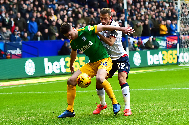 Preston North End's Andrew Hughes battles with  Bolton Wanderers' Jonathan Grounds<br /> <br /> Photographer Richard Martin-Roberts/CameraSport<br /> <br /> The EFL Sky Bet Championship - Bolton Wanderers v Preston North End - Saturday 9th February 2019 - University of Bolton Stadium - Bolton<br /> <br /> World Copyright &copy; 2019 CameraSport. All rights reserved. 43 Linden Ave. Countesthorpe. Leicester. England. LE8 5PG - Tel: +44 (0) 116 277 4147 - admin@camerasport.com - www.camerasport.com