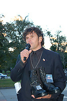 Carlos Arredondo with combat boots of his deceased son Alex who died in battle  in Najaf Iraq at an anti war vigil at Park Street in Boston MA marking the death of the 2000th soldier in Iraq 10.26.05