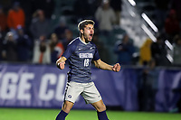 CARY, NC - DECEMBER 15: Aidan Rocha #18 of Georgetown University reacts after scoring what turned out to be the championship winning penalty kick during a game between Georgetown and Virginia at Sahlen's Stadium at WakeMed Soccer Park on December 15, 2019 in Cary, North Carolina.