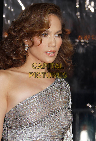 "JENNIFER LOPEZ .""The Back-up Plan"" Los Angeles Premiere held at the Regency Village Theatre, Westwood, California, USA, 21st April 2010. .arrivals headshot portrait earrings wavy hair one shoulder silver sleeve shiny shimmery make-up profile .CAP/ADM/MJ.©Michael Jade/AdMedia/Capital Pictures."