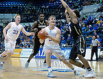 December 19, 2016:  Air Force guard, Zach Kocur #5, is tied up under the basket during the NCAA basketball game between the University of Colorado Buffaloes and the Air Force Academy Falcons, Clune Arena, U.S. Air Force Academy, Colorado Springs, Colorado.  Colorado defeats Air Force 75-68.
