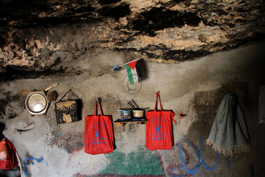 """A cave in Jenba a Palestinian town of 50 families seats in an area called by the IDF as """"Firing Zone 918"""" and is located in the southern Hebron hills near the town of Yatta.  Spread over 30,000 dunams, it includes twelve Palestinian villages.  According to OCHA figures, 1,622 people lived in the area in 2010, and according to local residents the number of inhabitants currently stands at about 1,800. For over a decade, the residents of twelve uniquely traditional Palestinian villages in the area of Masafer-Yatta in the south Hebron hills have lived under the constant threat of demolition, evacuation, and dispossession.<br /> <br /> The State's insistence on evacuation of Firing Zone 918 in part or in whole, if acceptance by the HCJ, might result in an immediate humanitarian disaster for almost two thousand souls, the destruction of villages, and the eradication of a remarkable way of life that has endured for centuries."""