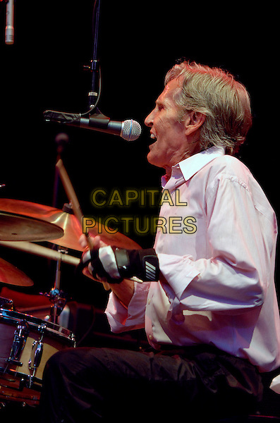 LEVON HELM.The Bowery presents: The Levon helm Band for a Summerstage benefit concert to support the free programs of Central Park Summerstage at Central Park, New York, New York, USA, 28 June 2007..half length live gig music pink shirt profile drums drumming.CAP/ADM/BL.©Bill Lyons/AdMedia/Capital Pictures. *** Local Caption ***