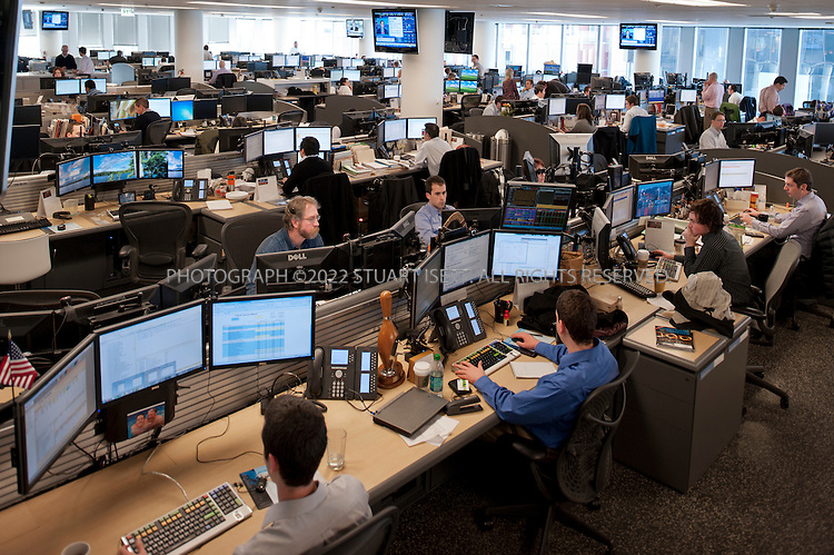 1/30/2012--Seattle, WA, USA..The trading floor at Russell Investments. The company's offices, on floors 14-18 in the former Washington Mutual tower in downtown Seattle, WASH., are designed with a totally non-hierarchical environment: there are no private offices for its 1,000 employees.  ..NBBJ, a Seattle-based architecture firm with global reach, has been creating office environments with concepts such as open, non-hierarchical workspaces, nodes designed for casual, unscheduled meetings, and a variety of environments where employees are free to roam and work from their laptops...©2012 Stuart Isett. All rights reserved.