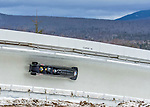 9 January 2016: United Kingdom pilot John James Jackson leads his 4-man team as they cruise through Curve 14 during their second run of the day at the BMW IBSF World Cup Bobsled Championships at the Olympic Sports Track in Lake Placid, New York, USA. Jackson's team came in 16th for the day, with a 2-run combined time of 1:51.80. Mandatory Credit: Ed Wolfstein Photo *** RAW (NEF) Image File Available ***