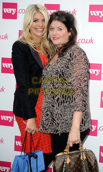 Holly & Kelly Willoughby.The Very.co.uk Fashion Preview for Spring and Summer 2012, Mercer Studios, London, England..September 20th, 2011.half length dress blazer jacket black orange dress print side beige grey gray sheer blouse sisters siblings family.CAP/WIZ.© Wizard/Capital Pictures.