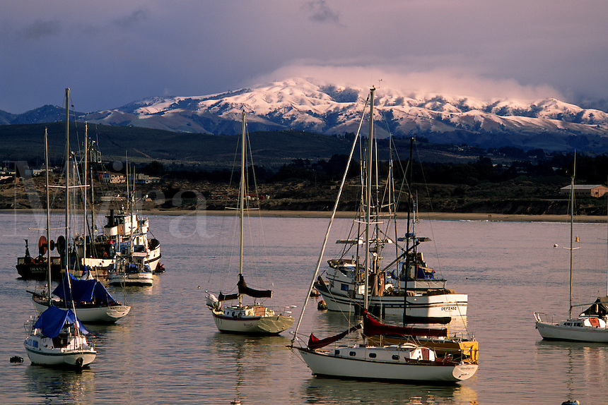 Monterey Bay is one of the world's most picturesque harbors. Shown here with a rare dusting of snow in the winter, Monterey Co.  California