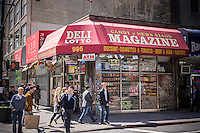 A corner deli in a taxpayer on Sixth Avenue in Midtown Manhattan in New York on Wednesday, April 24, 2013. (© Richard B. Levine)