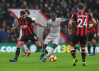 Bournemouth's Andrew Surman (left) battles with Liverpool's Naby Keita (right) <br /> <br /> Photographer David Horton/CameraSport<br /> <br /> The Premier League - Bournemouth v Liverpool - Saturday 8th December 2018 - Vitality Stadium - Bournemouth<br /> <br /> World Copyright © 2018 CameraSport. All rights reserved. 43 Linden Ave. Countesthorpe. Leicester. England. LE8 5PG - Tel: +44 (0) 116 277 4147 - admin@camerasport.com - www.camerasport.com