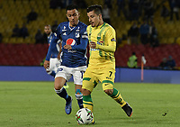 BOGOTA - COLOMBIA, 03-02-2019: Santiago Montoya de Millonarios disputa el balón con Sherman Cardenas de Bucaramanga durante partido por la fecha 3 de la Liga Águila I 2019 entre Millonarios y Atlético Bucaramanga jugado en el estadio Nemesio Camacho El Campin de la ciudad de Bogotá. / Santiago Montoya of Millonarios fights for the ball with Sherman Cardenas of Bucaramanga during match for the date 3 of the Liga Aguila I 2019 between Millonarios and Atletico Bucaramanga played at the Nemesio Camacho El Campin Stadium in Bogota city. Photo: VizzorImage / Gabriel Aponte / Staff.