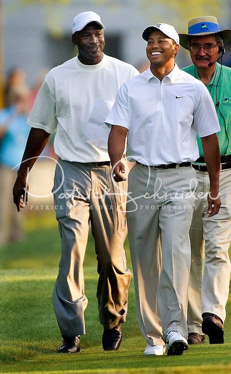 NBA legend Michael Jordan and PGA golfer Tiger Woods joke around as they play a practice round of golf during the 2007 Wachovia Championships at Quail Hollow Country Club in Charlotte, NC.