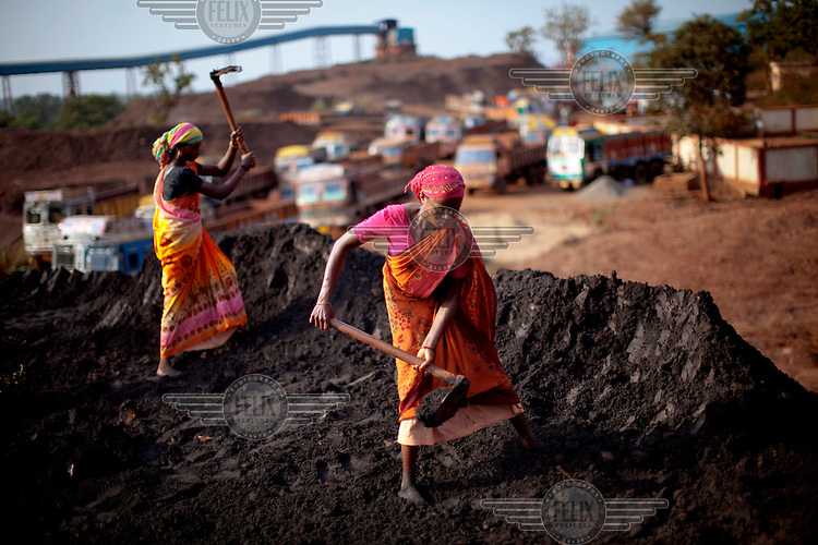 Local tribal women work as day labourers at the Indian state-owned National Mineral Development Corporation (NMDC), mine in Kirandul town, Dantewada district. In February 2006, Naxalite (Maoist) insurgents raided the NMDC mine, killing eight Central Industrial Security Force (CISF) personnel and seizing 20 tons of explosives, which are still being used to make improvised explosive devices (IEDs). Naxals attack mining and other government and corporate targets in protest of the forcible acquisition of local tribal peoples' agricultural land for industrial use. As the mine continues to expand, tribals are forced to sell their land, converting villagers from from land owning farmers to landless day labourers. /Felix Features